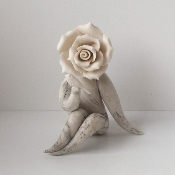 lady rose with bird flower sculpture