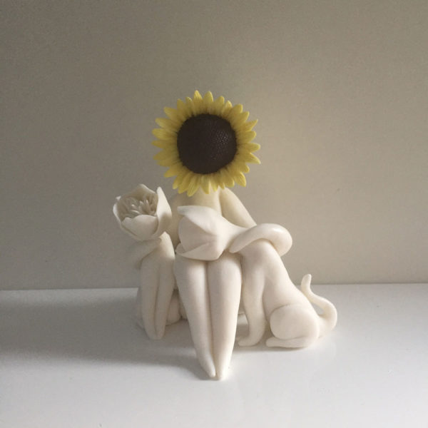 Sunflower lady two dogs flower sculpture