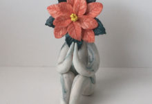 preying poinsettia flower sculpture