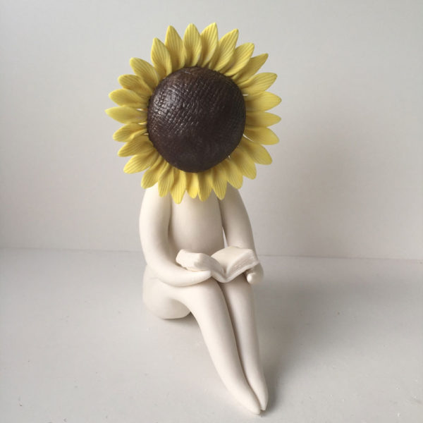 Sunflower Reading a book